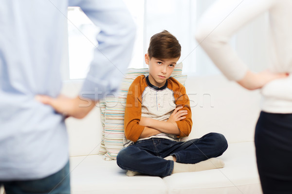 upset or feeling guilty boy and parents at home Stock photo © dolgachov