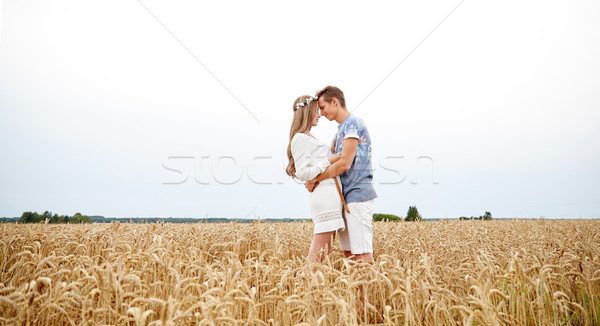 Feliz sorridente jovem hippie casal ao ar livre Foto stock © dolgachov