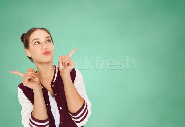 happy teenage student girl over green school board Stock photo © dolgachov
