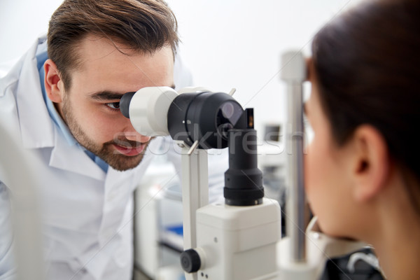 optician with tonometer and patient at eye clinic Stock photo © dolgachov