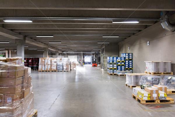 forklift loader and boxes at warehouse Stock photo © dolgachov