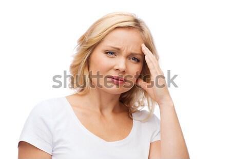 unhappy woman suffering from headache Stock photo © dolgachov