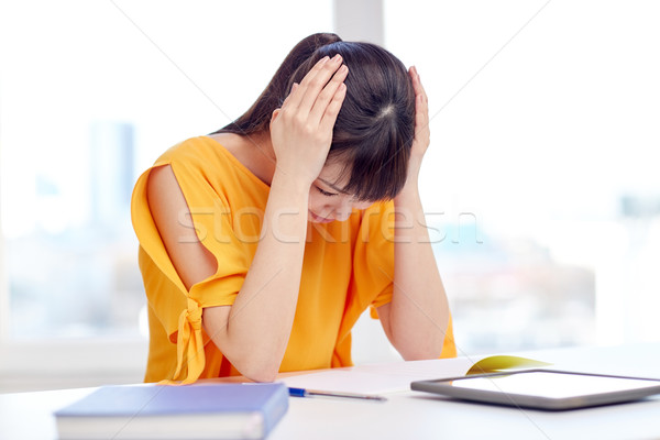 stressed asian young woman student at home Stock photo © dolgachov