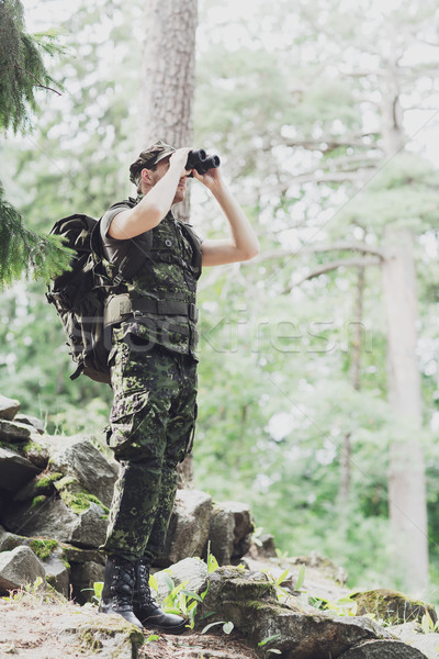 soldier with binocular and backpack in forest Stock photo © dolgachov