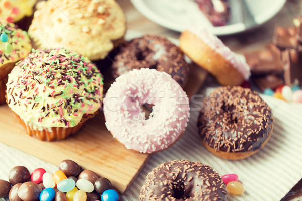close up of glazed donuts and sweets on table Stock photo © dolgachov