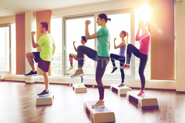 group of people working out with steppers in gym Stock photo © dolgachov
