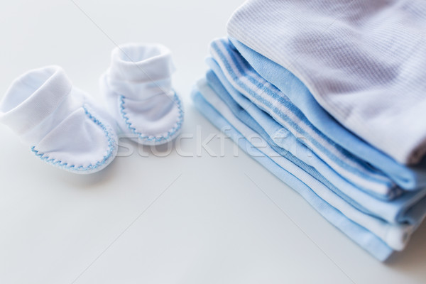 close up of baby boys clothes for newborn on table Stock photo © dolgachov