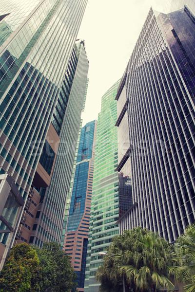 Felhőkarcolók város üzlet építészet ház üveg Stock fotó © dolgachov