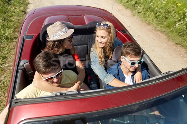 Felice amici guida cabriolet auto paese Foto d'archivio © dolgachov
