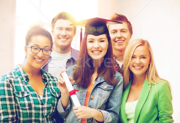 Meisje afstuderen cap certificaat onderwijs concurrentie Stockfoto © dolgachov