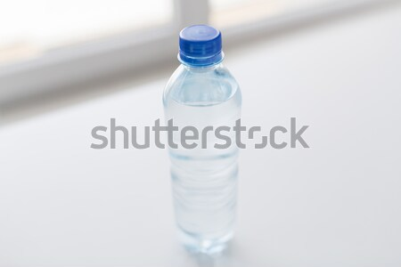 close up of bottle with drinking water on table Stock photo © dolgachov