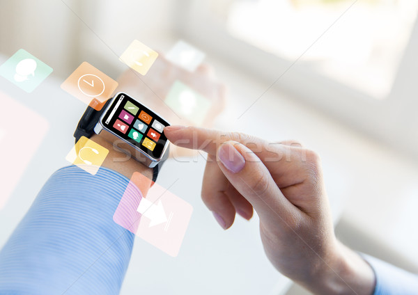 close up of hands setting smart watch with icons Stock photo © dolgachov