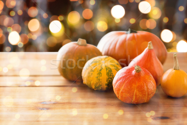 close up of halloween pumpkins on wooden table Stock photo © dolgachov