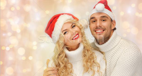 happy family couple in sweaters and santa hats Stock photo © dolgachov
