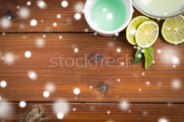 body lotion, cream and limes on wood Stock photo © dolgachov