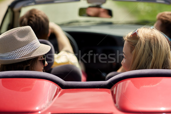 happy friends driving in convertible car at summer Stock photo © dolgachov