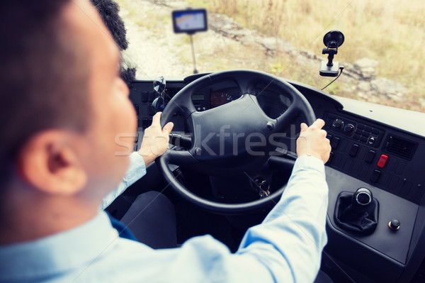 close up of driver driving passenger bus Stock photo © dolgachov