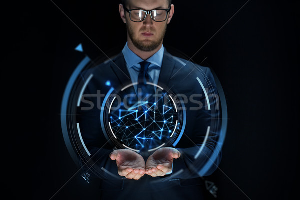 businessman with virtual projection over black Stock photo © dolgachov