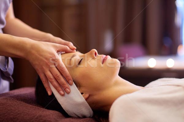 woman having face and head massage at spa Stock photo © dolgachov
