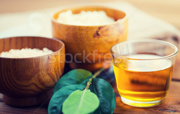 close up of honey in glass with leaves on wood Stock photo © dolgachov