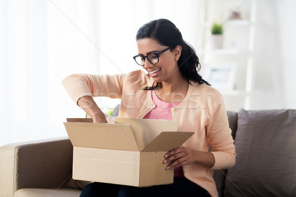 happy young indian woman with parcel box at home Stock photo © dolgachov