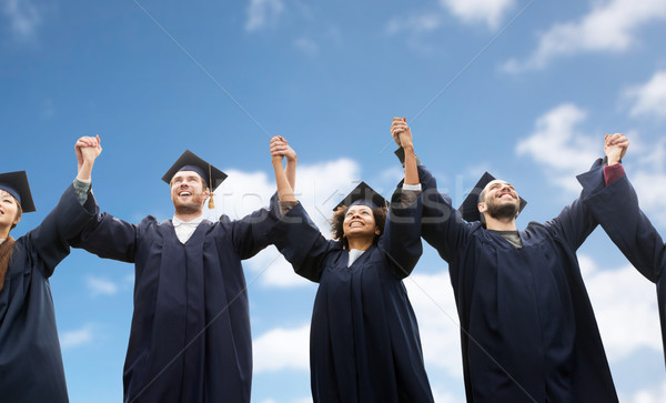 happy students or bachelors celebrating graduation Stock photo © dolgachov