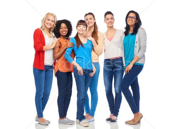 international group of happy smiling women Stock photo © dolgachov