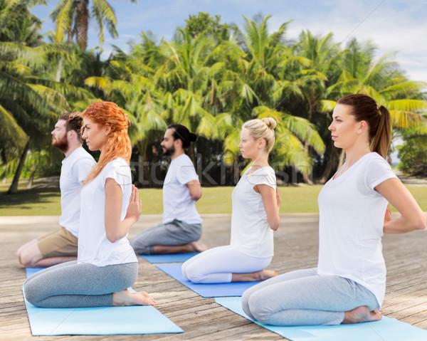 Pessoas ioga herói pose ao ar livre Foto stock © dolgachov