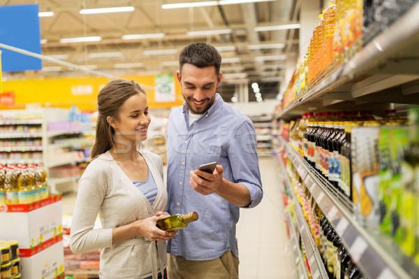 Pareja compra aceite de oliva comestibles compras Foto stock © dolgachov