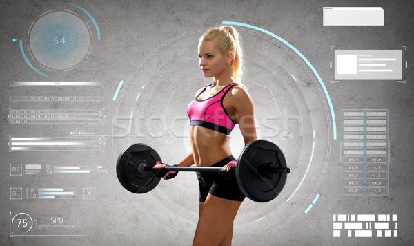 Jonge vrouw barbell sport Stockfoto © dolgachov
