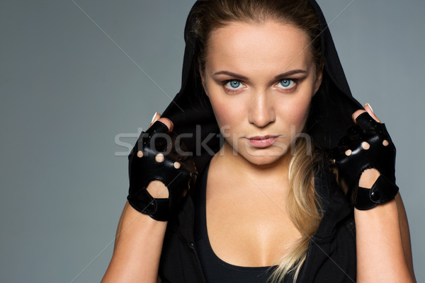 close up of woman in black sportswear Stock photo © dolgachov