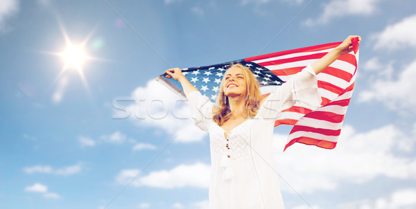 happy young woman with american flag over blue sky Stock photo © dolgachov