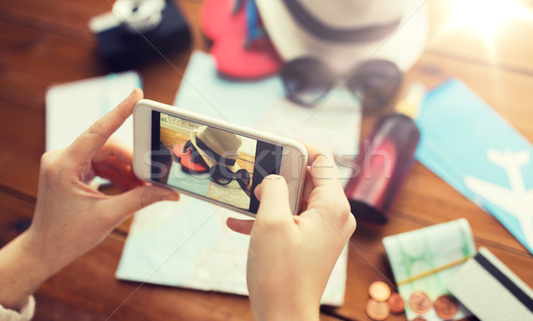 close up of woman with smartphone and travel stuff Stock photo © dolgachov