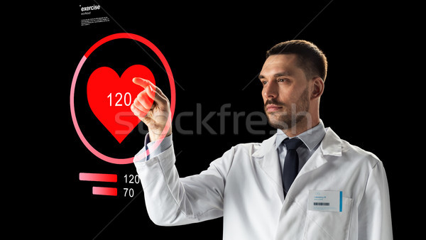 doctor or scientist with heart rate projection Stock photo © dolgachov