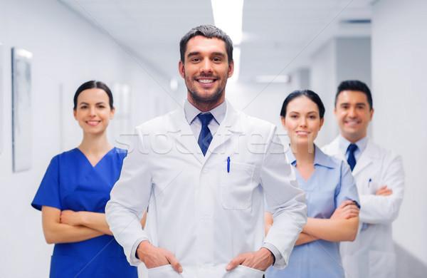 счастливым группа врачи больницу клинике профессия Сток-фото © dolgachov