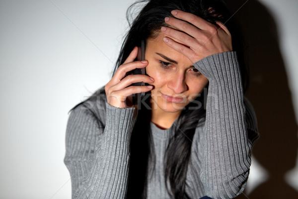 Płacz kobieta wzywając smartphone ludzi Zdjęcia stock © dolgachov