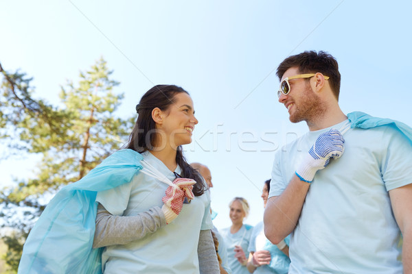 volunteers with garbage bags talking outdoors Stock photo © dolgachov