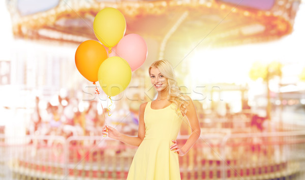 happy woman with air balloons over carousel Stock photo © dolgachov