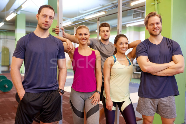 group of happy friends in gym Stock photo © dolgachov