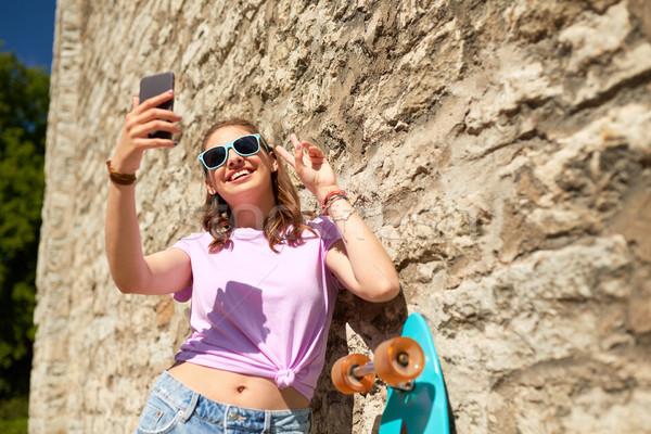happy teenage girl with longboard and smartphone Stock photo © dolgachov