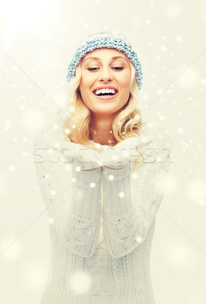 woman in winter heat showing empty palms Stock photo © dolgachov