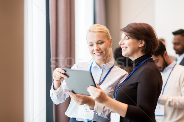 team with tablet pc at business conference Stock photo © dolgachov