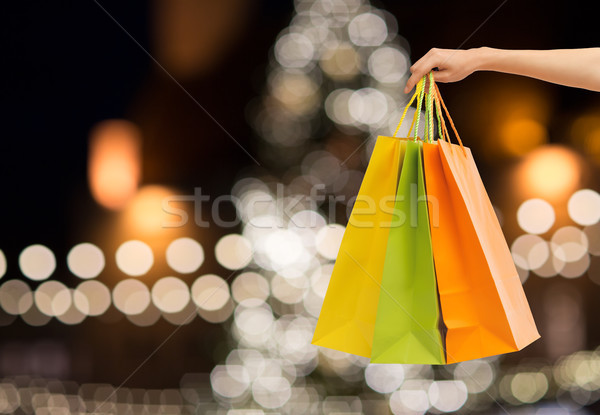 close up of hand with shopping bags at christmas Stock photo © dolgachov