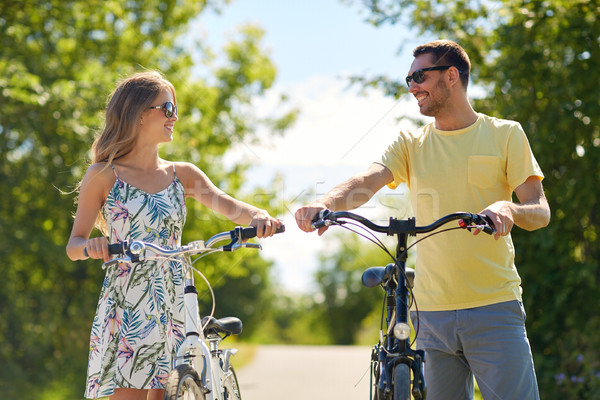 happy couple with bicycles on country road Stock photo © dolgachov