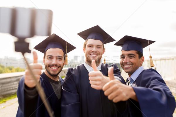 happy male students or graduates taking selfie Stock photo © dolgachov