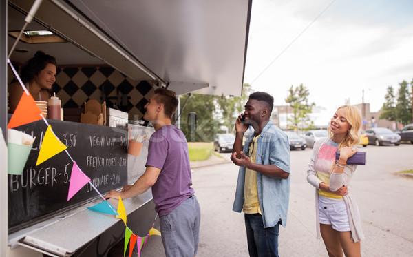 Feliz clientes fila comida caminhão rua Foto stock © dolgachov