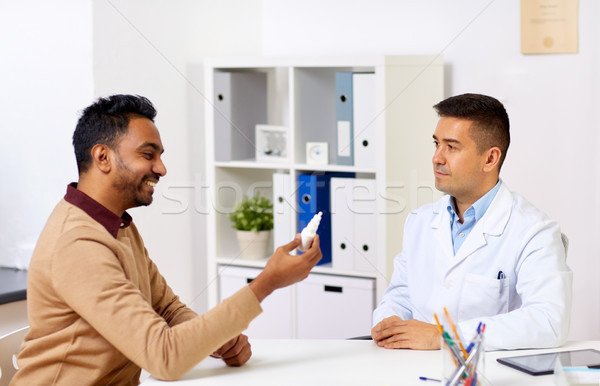 doctor and patient with nasal spray at hospital Stock photo © dolgachov