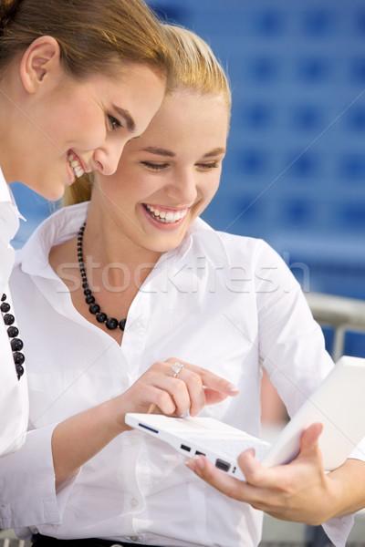 Város élet kettő boldog üzletasszonyok laptop Stock fotó © dolgachov