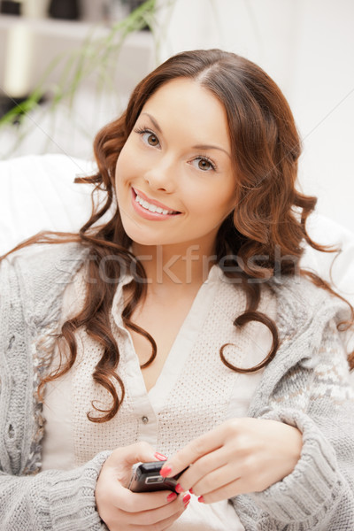 woman with cell phone Stock photo © dolgachov