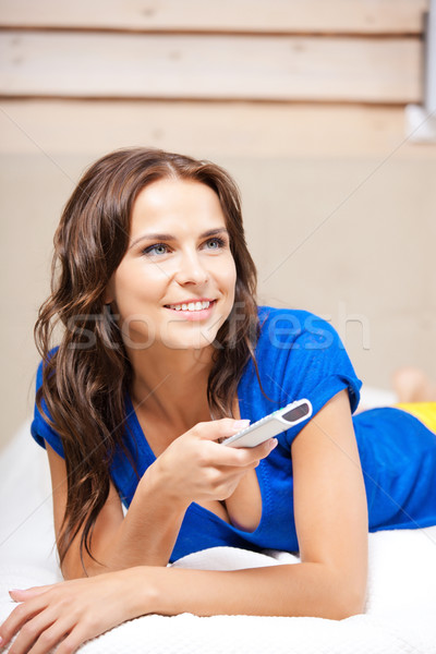 happy woman with TV remote Stock photo © dolgachov